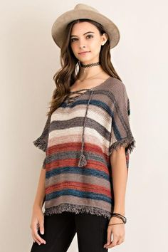 Fringed Sleeve Striped Top ($48) Effortless bohemian style with a southwestern flair. Features fringed sleeves and hem, tassel tie neckline, and trending fall stripes of rust, mocha, navy, and ivory. For a casual afternoon, pair with Distressed Light Wash Flare Jeans and layered gemstone and leather accessories.
