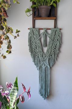 This simple, long macrame wall hanging will be a perfect fit in your eclectic, bohemian space! #macramewallhanging #eclecticbohemiandecor #sagegreenbohobedroom #greenboholivingroom #wallhangings Modern Crafts, Diy And Crafts, Boho Living Room, Diy Party Decorations, Bohemian Decor, Plant Hanger, Perfect Fit, Wall, Handmade