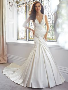 This design for a wedding dress is incredible deep V with sparkle satin and beautiful flare to the skirt
