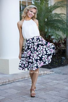 You'll have everything you wanted and more with this skirt! It features adorable floral print in green, white, and fuchsia on top of the black and dark navy print with an elastic band around the waist!