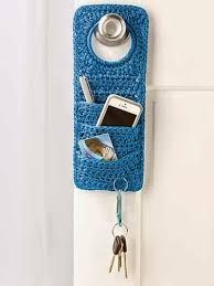 """"""" Doorknob Organizer - this crochet pattern is not free BUT it should not be too difficult to make one like it! what a neat idea! Shawl Crochet, Love Crochet, Crochet Gifts, Diy Crochet, Crochet Stitches, Crochet Stocking, Crochet Flowers, Crochet Organizer, Crochet Storage"""