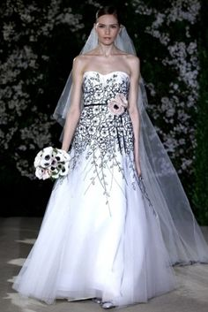 Black and white wedding dress with a touch of pink champagne by Carolina Herrera