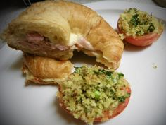 """This """"Ham & Cheese"""" got a major update. A super secret spread on soft croissant and then baked until ooeey gooey was just what this usual boring sandwich needed. These tomatoes were a great companion! Stuffed baked tomatoes were delicious!"""