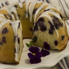 Blueberry Bundt Cake Recipe... Bursting with fresh blueberries and draped with a lemon glaze, this cake is ideal for breakfast, brunch or dessert.