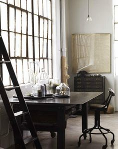Lovely room. Great windows. Fab furniture. An industrial look I'd love to live with.