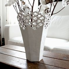 Beautiful vase would look amazing with a bright bouquet placed in an entryway    Porcelain lattice vase by Isabelle Abramson