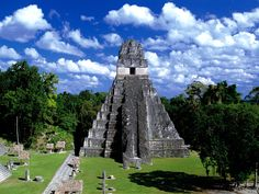 """Tikal, Guatemala The structures of Tikal, one of the largest archaeological sites of the Mayan civilization, are mostly made of soft limestone -- soft enough to erode when subjected to rain and wind. Tourists aren't helping, either; many have been known to leave with small stone """"souvenirs."""""""