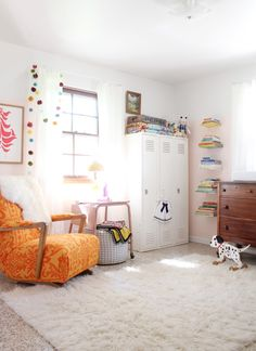 Love this nursery tour - everything about it. Love lockers, floating book shelves, little table and the pom pom garland