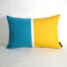 Turquoise blue and lemon yellow color block crafted from Sunbrella indoor outdoor fabric.  #mazizmuse #ColorfulPillows #SunbrellaPillows #OutdoorPillows #ColorBlockPillows