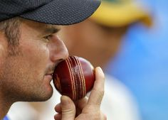 PERFUME BALL: New Zealand's wicketkeeper Kruger Van Wyk holds a ball as he sits near the boundary rope during the fourth day of their second test cricket match against India in Bangalore, September 3, 2012.