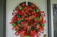This gorgeous Christmas wreath starts with a work wreath with metallic green and red deco mesh. Other elements of this wreath are red and Christmas Picks, Christmas Mesh Wreaths, Winter Wreaths, Christmas Bows, Deco Mesh Wreaths, Christmas Trees, Christmas Holidays, Christmas Crafts, Christmas Decorations