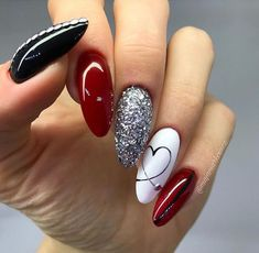 Valentine Nail Style. Use of Reds with a mix of black and white. Finish off with accent glitter and heart design. #NailStyles #Colors #Valentines #Red #Black #White #Glitter #Design