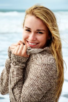 Portrait at the ocean Photo by Myle Collins Mylestone Photography Portrait girl, portrait woman, posing girl, posing for woman, senior portrait, portrait at the beach, portrait at the ocean, holding sweater