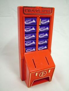 Cadury's Chocolate Machine money box Photo of Cadbury Chocolate machine money box full of miniature Dairy Milk chocolates, taken from TV Cream Toys .uk - more photos, plus write ups, at the web site.
