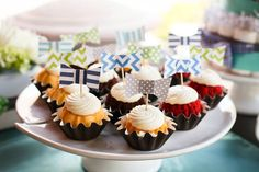 Bow tie cupcake toppers on mini bundtini's-different toppers but this is cute!