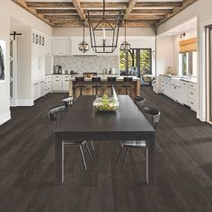 Grey, dark wood-look flooring. Pergo Extreme Wood Originals in Volcanic Ash