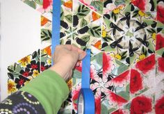 Use painters tape to tape your quilt pieces to keep them in order as you sew