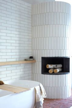the optimal tile for executing unique pattern installation - architect's palette. #bathroomdesign #bathroomidea #curvedfireplace