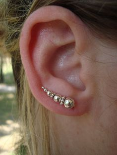 I'm digging this new ear pin concept. Sterling Silver Beaded Ear Pins by AwarenessProducts on Etsy, $25.00
