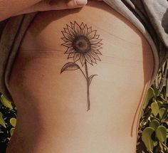 Simple Sunflower Side Boob Rib Tattoo Ideas for Women at MyBodiArt.com