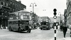 This very early 1960's view looks north to the Hampstead Road that leads to Camden Town and where the RM on trolleybus replacement route 269 has come from. The RT on route 1 is turning from Euston Road into Tottenham Court Road. The junction here makes the Euston Road look incredibly narrow. This picture was taken shortly before the final trolleybuses ran in this location and Tottenham Court Road succumbed to the one-way traffic scheme. It's been pointed out that none of the buildings...