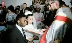 Pele dabs the sweat from his brow during his wedding to Rosemeri dos Reis Cholby in a stifling hotel room crowed with family, friends and press in Santos, Brazil (February 21st 1966)