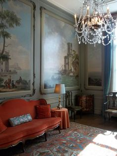 orange sofa and blue painted walls or wallpaper