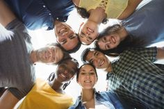 Group of business executives forming huddle Free Photo