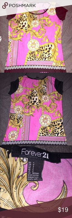 Pink, gold, and cheetah designed shirt I got this shirt from forever21, some signs of wear and discoloration in some places as shown in pictures but it's still in great condition condition. Feel free to make an offer Forever 21 Tops Blouses