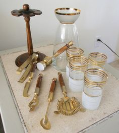 I love this (expensive) vintage bar set. It has all the pretty tools, decanter, and glasses.