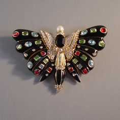 CINER black enameled butterfly brooch with red, green from Morning Glory Jewelry. Buy now for $398.00