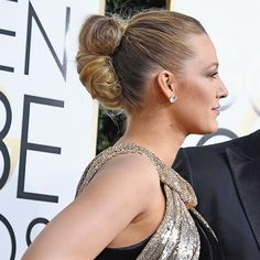 Sleek Updo - At the 2017 Golden Globes, Blake's updo looked sleek and polished from the front, but we were also lovingthe details in the back. Her long blonde locks were twisted and pinned togetherto create a non-traditional bun.