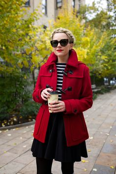 black flare skirt - black tights - black and white striped top - red duffel coat - red lipstick - sunglasses - red nail polish