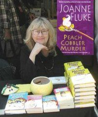 I love Joanne Fluke's murder mystery series about Hannah Swenson who owns her own cookie shop. Light, clean reading and recipes are included. I only have two more and I will have read the entire series! Also, see www.murdershebaked.com.