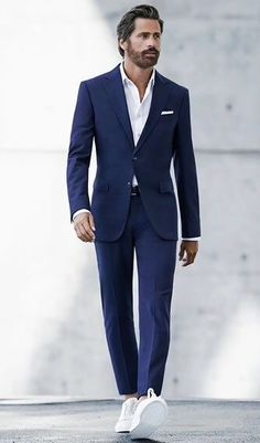 Simple look.. navy suit with a white oxford shirt and white sneakers. Nice combo to use for a wedding or the work #menswear #weddingoutfit #styleinspiration #mensfashion #menstyle