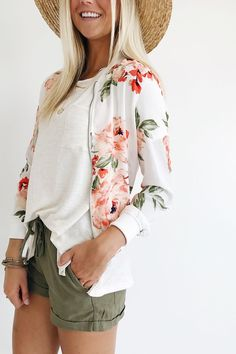 Ivory Bomber Jacket  Pink Floral Print  Zipper Front w/Pockets  Loose Fit  Elastic Hem + Cuffs  Slightly Sheer  Model is 5'9 + wearing a size small