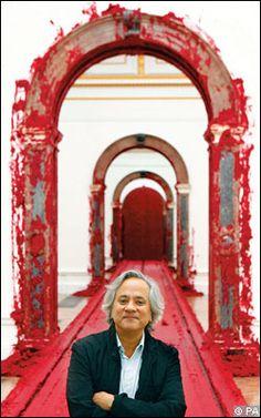 Anish Kapoor standing in front of his artwork 'Svayambh'