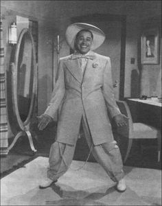 """Cabell """"Cab"""" Calloway III was an American jazz singer and bandleader. He was strongly associated with the Cotton Club in Harlem, New York City, where he was a regular performer. Der Gentleman, The Blues Brothers, Vintage Black Glamour, Vintage Men, African American History, Mae West, Black People, Black Is Beautiful, Musical"""
