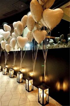 Balloons and lanterns line up the entryway to the wedding reception. #balloon #decoration #weddings #ideas