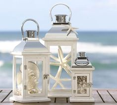 Lanterns filled with shells and starfish instead of candles suit the seaside wedding theme perfectly!