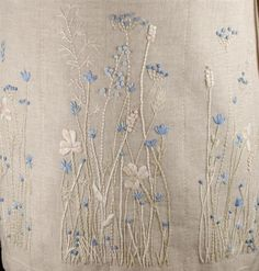 Fleur bleue embroidery...ivory and light blue floss. Close to a monochromatic look. Lovely.: