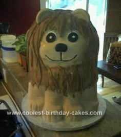Homemade Baby Lion Cake: I made this Homemade Baby Lion Cake for a friend's baby shower. I used vanilla sponge for the layers alternating with rice krispie treat layers. I used