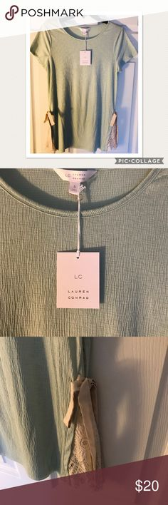 NWT Lauren Conrad blouse with lace size S This NWT Lauren Conrad short sleeve blouse is simple but incredibly cute with lacing and bows on both sides of the shirt. It has no wear and tear or staining and has all original tags attached. Never been worn! LC Lauren Conrad Tops Blouses