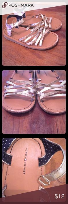 Tommy Hilfiger Gold Sandals Adorable for stylish little ladies!  Some signs of wear on front of shoe but not really noticeable while they are on - otherwise great condition! Tommy Hilfiger Shoes Sandals & Flip Flops