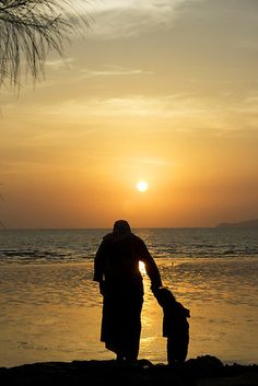 Silhouette of a mother and son in sunset, like the feel.