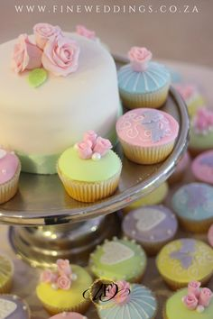 This beautiful wedding cake and cupcake combo was created with a variety of sugar icing designs and sugar roses. Pretty Cupcakes, Wedding Cakes With Cupcakes, Mini Cupcakes, Cupcake Cakes, Cup Cakes, Sugar Rose, Sugar Icing, Beautiful Wedding Cakes, Create