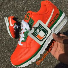 Nice University of Miami Air Maxes done by team member Great work as always! Miami Hurricanes Apparel, University Of Miami Hurricanes, Hurricanes Football, Hurricane Bar, U Of Miami, Understanding Football, Tailgate Outfit, Painted Shoes