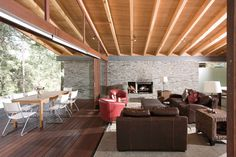 : Fantastic Decoration Of Toc House Living Room Indoor Meets Outdoor With Different Flooring But Same Ceiling Separated By Folding Door
