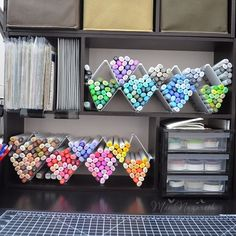 like this pen and pencil idea and the slots wouldn't have to be huge...vertical storage!!!