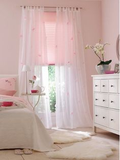 This looks like an Ikea idea room circa 2010. Soft pink and sheers are light and airy.